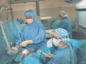 Dr. Michael Lau performing laser surgery